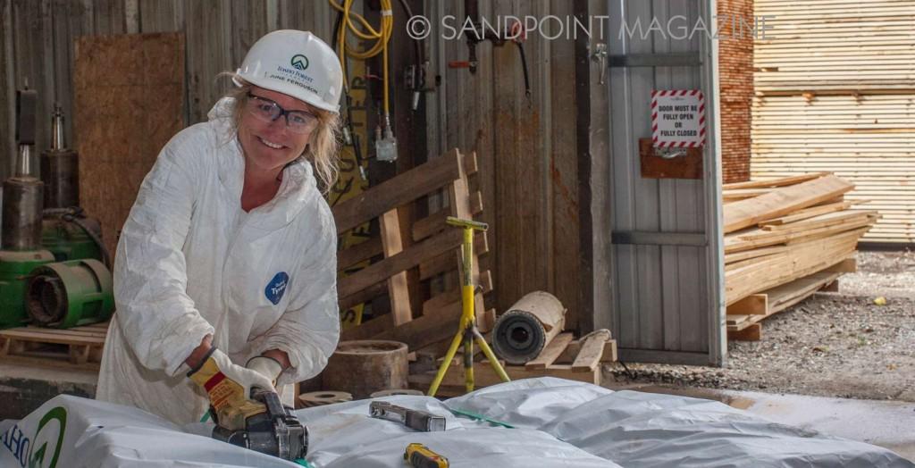 One of few women in production, June Ferguson works in packaging, above